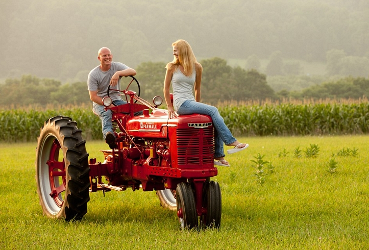 Couple On Tractor : A romantic young couple cornfield and an antique